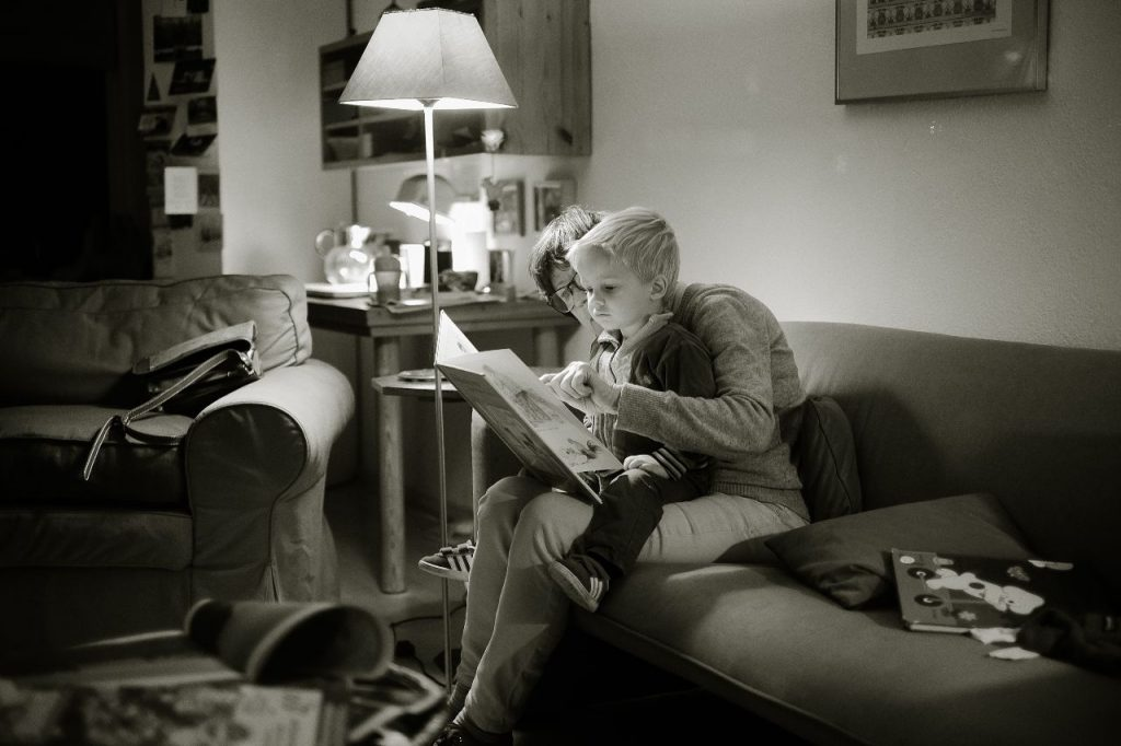 Mother reading aloud for baby